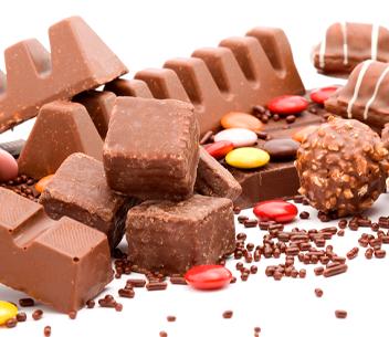 CHOCOLATES, CACAU E BALAS